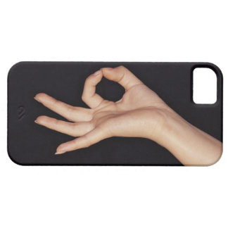 Studio shot of hand gesturing a sign case for the iPhone 5