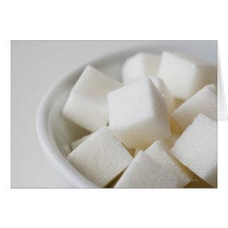 Studio shot of sugar cubes in bowl card