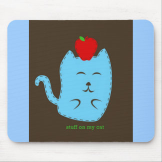 stuff on my cat - apple on head mouse pad