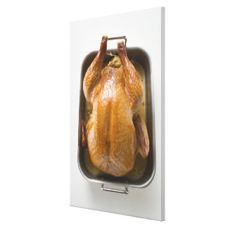 Stuffed roast turkey in roasting tray, close up canvas print