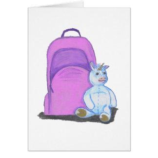 Stuffed Unicorn sits by a purple school Backpack Card