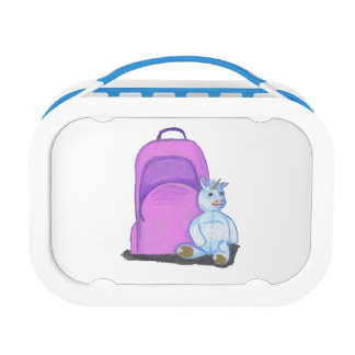 Stuffed Unicorn sits by a purple school Backpack Lunch Box