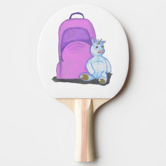 Stuffed Unicorn sits by a purple school Backpack Ping Pong Paddle