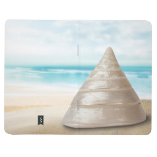 Stunning shimmering sea snail shell on the beach journal