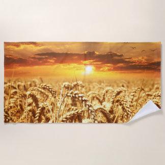 Stunning wheat field sunset beach towel