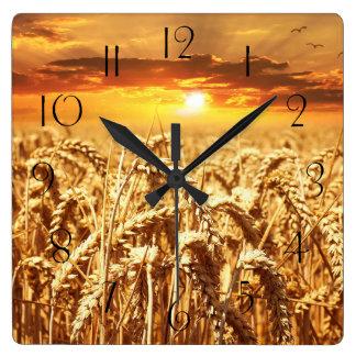 Stunning wheat field sunset square wall clock