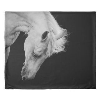 Stunning white horse on black looking down duvet cover