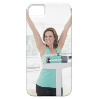 Successful weight loss. Happy woman weighing iPhone 5 Case