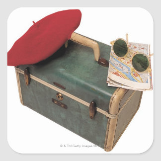 Suitcase , beret , map , and sunglasses square sticker