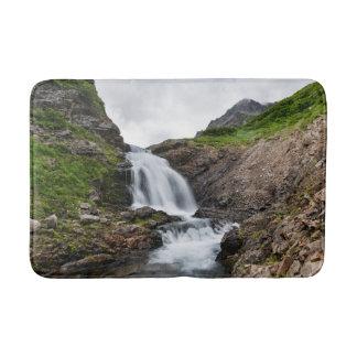 Summer beautiful waterfall in mountain range bathroom mat