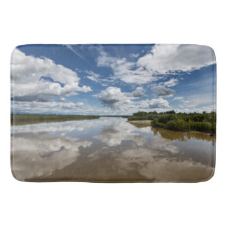 Summer landscape: clouds reflection in water bathroom mat