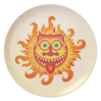 Summer shiny sun grinning and sticking tongue out plate