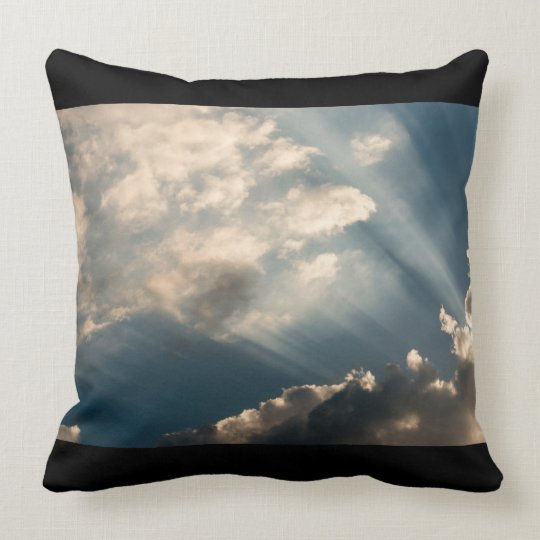 Sun casting beams trough the clouds throw pillow
