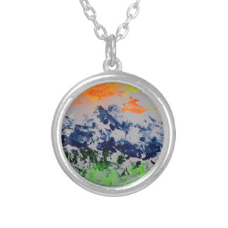 Sun over snow clad mountains silver plated necklace