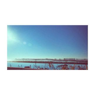 Sun rays over the blue lagoon canvas print