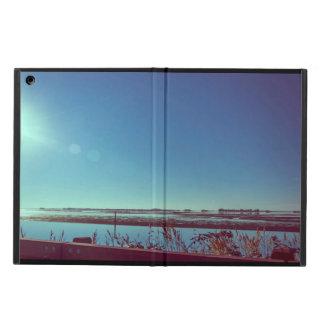 Sun rays over the blue lagoon cover for iPad air