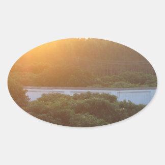 Sun rise sun set oval sticker
