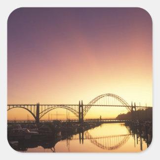 Sun setting behind the Newport Bridge, Oregon Square Sticker