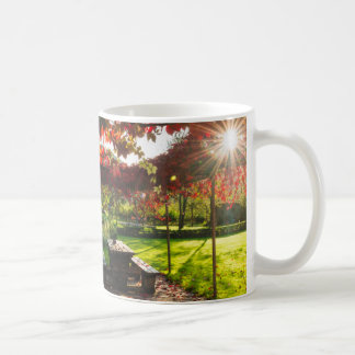 Sun through autumn leaves, Croatia Coffee Mug