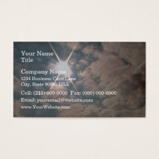 Sunburst through white clouds business card