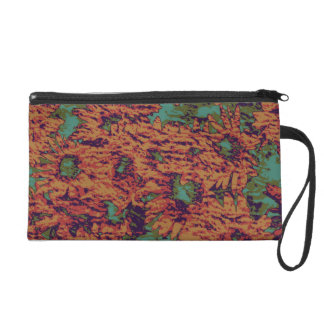 Sunflower and leaf camouflage pattern on wristlet purses