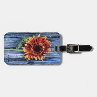 Sunflower on Blue Fence Luggage Tag