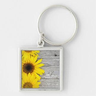Sunflowers on a table keychain