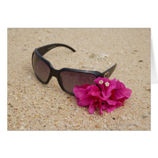Sunglasses and bougainvillia flowers on coral card