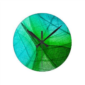 Sunlight Filtering Through Transparent Leaves Round Clock