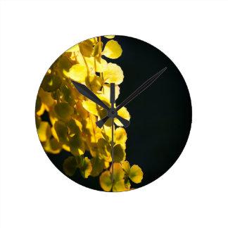 Sunny leaves round clock