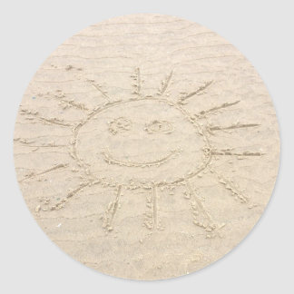 Sunny smiley face sunshine. Drawing on the beach Round Sticker