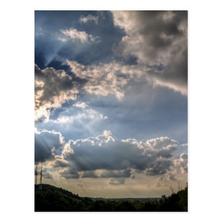 Sunray through clouds postcard