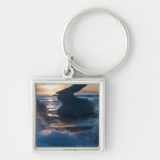 Sunrise and iceberg formation on the beach Silver-Colored square keychain