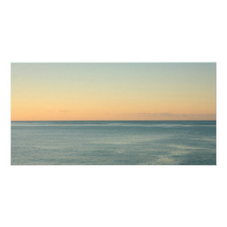 Sunrise and serene ocean photo greeting card