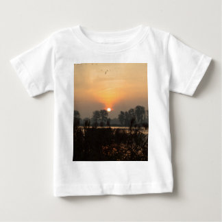Sunrise at a lake with flying birds. baby T-Shirt