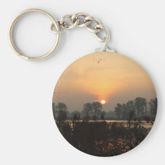 Sunrise at a lake with flying birds. basic round button keychain