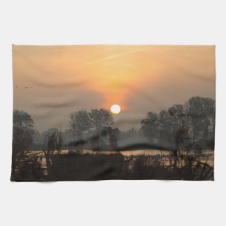 Sunrise at a lake with flying birds. hand towel
