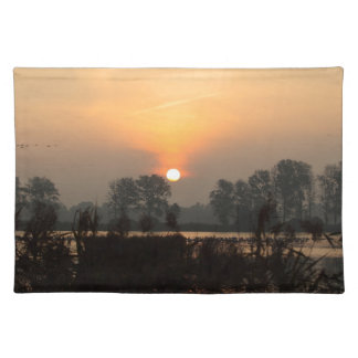 Sunrise at a lake with flying birds. placemat