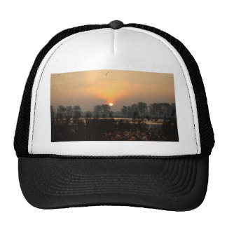 Sunrise at a lake with flying birds. trucker hat