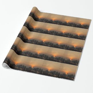 Sunrise at a lake with flying birds. wrapping paper