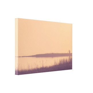Sunrise by an idyllic lake canvas print