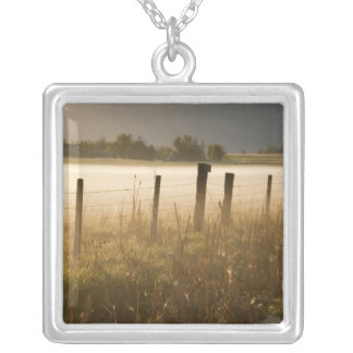 Sunrise lights fog along fence near Charlo Silver Plated Necklace