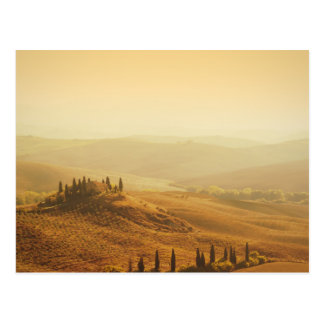 Sunrise over a landscape in Tuscany postcard