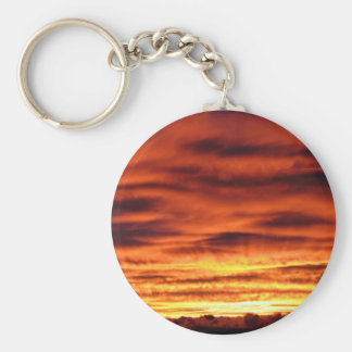 Sunrise peeking through the clouds keychain