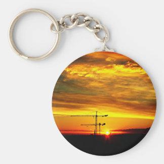 Sunrise silhouetting Cranes Basic Round Button Keychain