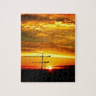 Sunrise silhouetting Cranes Jigsaw Puzzle