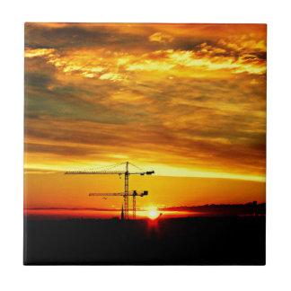 Sunrise silhouetting Cranes Tile