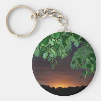 Sunrise under the trees basic round button keychain