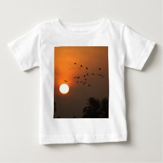 Sunrise with flocks of flying cranes baby T-Shirt