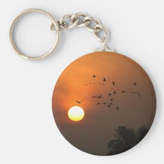 Sunrise with flocks of flying cranes basic round button keychain
